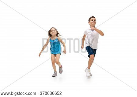 Happy Kids, Little And Emotional Caucasian Boy And Girl Jumping And Running Isolated On White Backgr