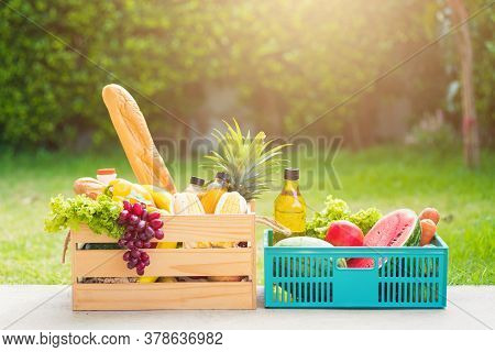 Full Fresh Vegetables And Fruits In Crate Wood Box, Harvest Organic Food On The Garden Place Of Gree