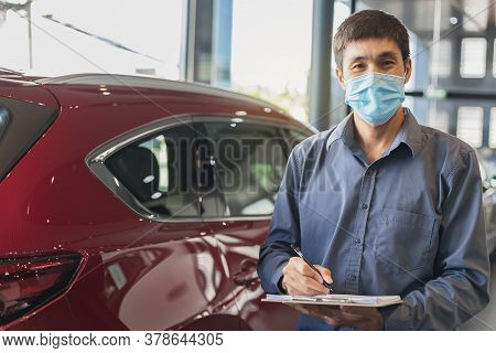 Asian Saleman Wear Surgical Mask Working In Inspector Checking Writing On Clipboard In Garage Of Dea