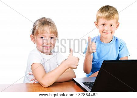 Happy Girl And Boy Behind Laptop With Thump Up Sign Isolated Over White