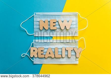 New Reality Words On Protective Face Masks On Blue And Yellow Background. Post Covid-19 Pandemic Cha