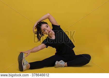 Smile Happy Beautiful Portrait Young Asian Woman Stretching Exercise Workout On Yellow Background, F