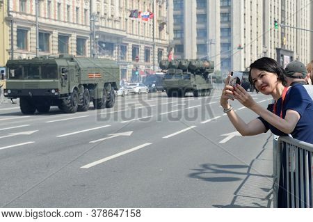 Moscow, Russia - June 24, 2020:an Unknown Girl Photographs Military Equipment On Moscow's Mokhovaya