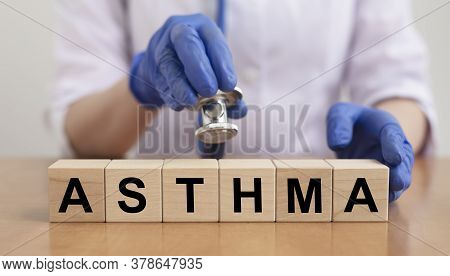 Text Word Of Asthma On Cubes With Blurred Doctor On Background