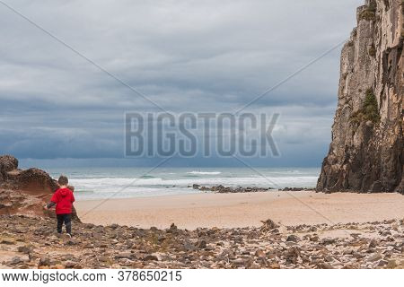 Child Walking On The Rocks, Guarita Park, Is A Brazilian Conservation Unit Located In The Southern R