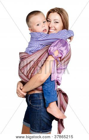 Happy Mother Hugging Her Baby Boy 3-4 Years Old In Sling Isolated On White Background