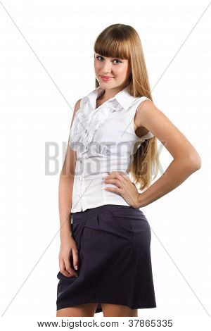 Portrait Of Cute Teen Girl Wearing White Shirt And Skirt Isolated Over White