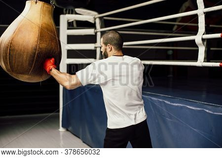 Close Up Male Boxer Boxing In Punching Bag, Slow Motion