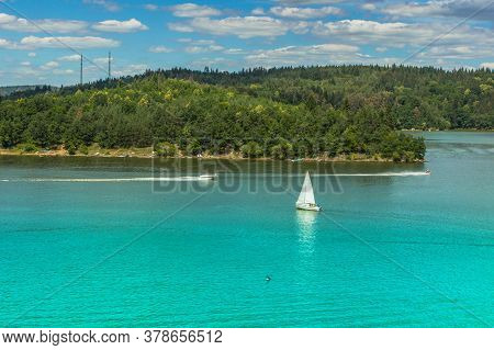 Yachts And Boats Sailing Across The Blue Water In Sunny Summer Day. Travel Picturesque Landscape. Ya