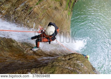 Canyoneering Furco Canyon in Pyrenees, Broto village, Huesca Province in Spain.