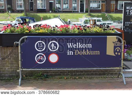 Dokkum, Netherlands, 22 July 2020: Signage Saying 'welcome To Dokkum' Showing Physical Distancing Re