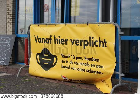 HOLWERD, NETHERLANDS, 23 JULY 2020: Signage in Dutch, stating that mouth masks are mandiaory. Wearing a face mask whilst using public transport in Holland is manditory to stop the spread of the Covid-19 virus.