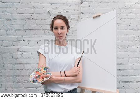 Beautiful Woman Posing, Holding Color Palette With Brush, Artist In White T-shirt. White Blank Canva