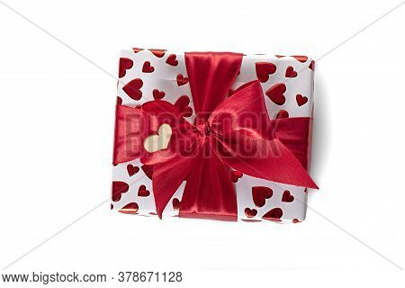 Gift Box Wrapped In White Paper With Red Heart Texture. And Wrapped In A Pink Ribbon.
