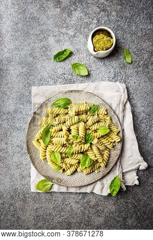 Italian Fussili Pasta With Basil Pesto And Fresh Basil On Gray Stone Background. Top View.