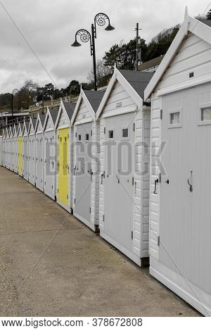 Colorsplash Of A Row Of Beach Huts At Lyme Regis In Dorset.