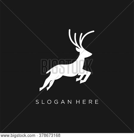 Jumping Deer Logo, Black Silhouette Of Graceful Deer In Jump With Great Antlers. Vector Flat Icon Is