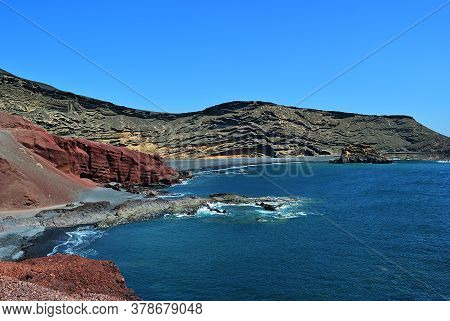 Lanzarote, Black Sandy Beach In Gulf Of El Golfo, Atlantic Ocean Near Lago De Los Clicos In Canary I