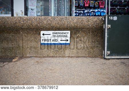 Hunstanton, Norfolk, England, Uk - July 25, 2020: Information Sign - Emergency Telephone, First Aid