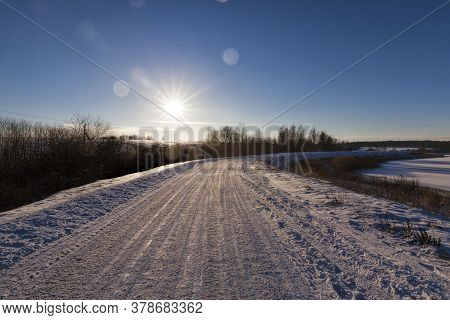 Winter Time On The Road, The Road Is Covered With Snow After Snowfall, Frosty Weather On A Slippery
