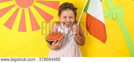 Little Girl On A Bright Background With The Italian Flag Holding A Fruit Basket In Her Hands. The Co
