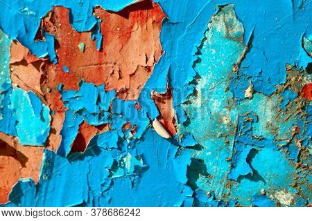 Cracked And Peeling Paint On The Wall. Grunge Old Texture - Abstract Background. Scratched And Chipp