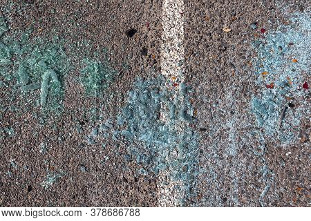 Broken After An Accident And Traffic Accident, An Asphalt Road On Which There Is Small Glass From Th