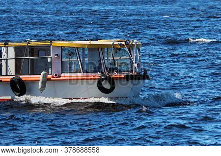 Pleasure Boat For Passengers Floats On The Sea.