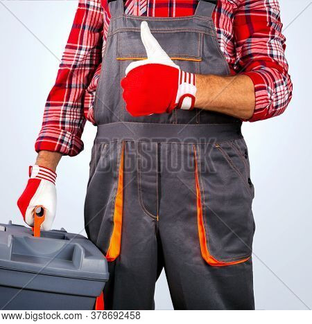 Repairman With Toolbox Showing Thumbs Up Sign.