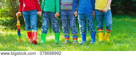 Kids In Rain Boots. Group Of Kindergarten Children In Colorful Rubber Boots And Autumn Jackets