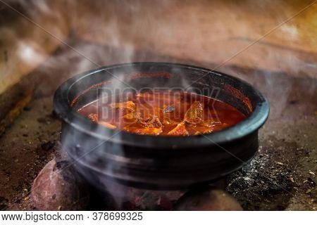 Kerala Fish Curry. Clay Pot Cooking In Kerala.