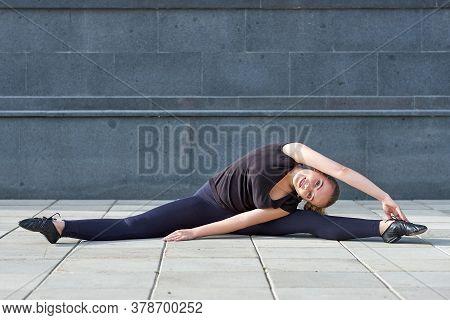 Stretching Gymnast Woman Doing Split, Twine In Workout Sports Ground