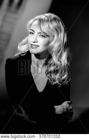 Monochrome Fashion Portrait Of Beautiful Blonde Woman In Glamour Black Dress