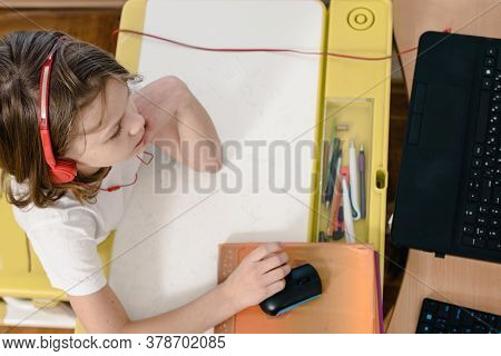 Top View Of Young Boy Using Laptop To Study Online Learning At Home During Quarantine