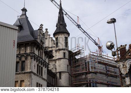 Antwerp, Belgium, July 19, 2020, Back Of Castle Het Steen With Crane And Scaffolding For The Renovat