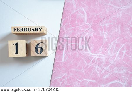 February 16, Empty White - Pink Background With Number Cube.