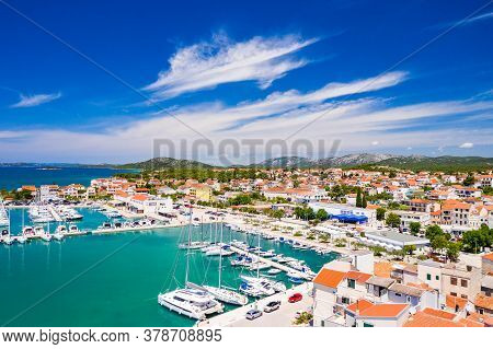 Croatia, Adriatic Coastline, Coastal Town Of Pirovac, Waterfront View Of Old Buildings And Boats In