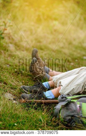 Closeup Of Kids Legs Resting On Green Grass After Hiking In Carpathians
