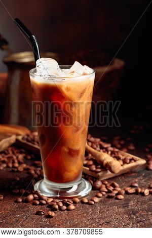 Ice Coffee With Cream Being Poured Into It Showing The Texture And Refreshing Look Of The Drink. Fro