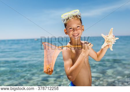 Little Boy Playing With Seastar On Sea Background