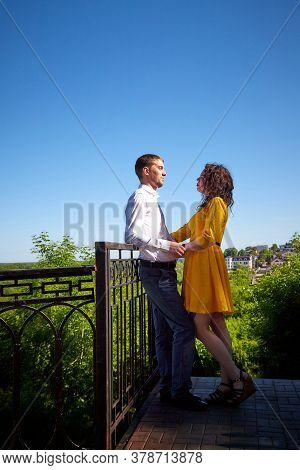 A Date Between A Young Girl And A Guy On A Sunny Summer Day. Young Beautiful Couple On Walk In The C