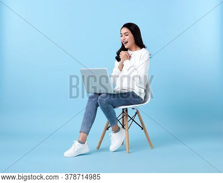 Young Woman Asian Happy Smiling In Casual White Cardigan With Denim Jeans.while Her Using Laptop Sit