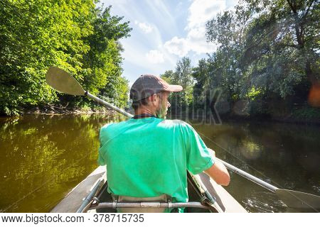 Canoeing  on the summer river
