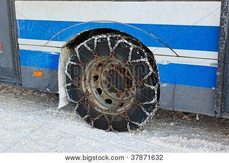 Snow Winter Chains On Tyre Of Car