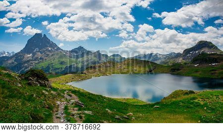View Of Pic Du Midi Ossau And Ayous Lake In French Pyrenees Mountains