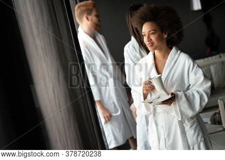 Portrait Of A Beautiful Young Woman Drinking Tea Dressed In A Bathrobe In A Wellness Spa Center