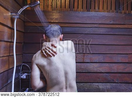 Asian Man's Showering In Bathroom For Clean A Body And Relax By Bare And Water Drops From Shower To