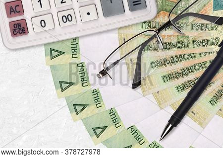 50 Belorussian Rubles Bills Fan And Calculator With Glasses And Pen. Business Loan Or Tax Payment Se