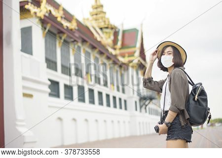 A Young Pretty Asian Woman Is Wearing Protective Mask Travelling Around Famous Places In Bangkok Cit