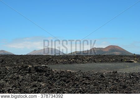 The Vast Emptiness And Loneliness Of The Lanzarote Black Frozen Lava Volcanic Desert And Volcanoes I